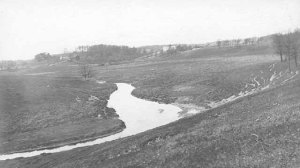 """Bassett's Creek in the vicinity of Glenwood Spring about 1910 according to the Minnesota Historical Society. I'm not familiar enough with the lay of the land in the area to guess the exact location of this scene, but I was struck by how open the landscape was,especially given Cleveland's description of """"the presence of large bodies of very fine native trees."""" Perhaps they were behind teh photographer who took this picture. (Minnesota Historical Society)"""