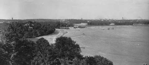 Lake Calhoun's northwest shore and Bath House in late 1910s. Photo taken from Minikahda Club. (Minneapolis Park and Recreation Board)