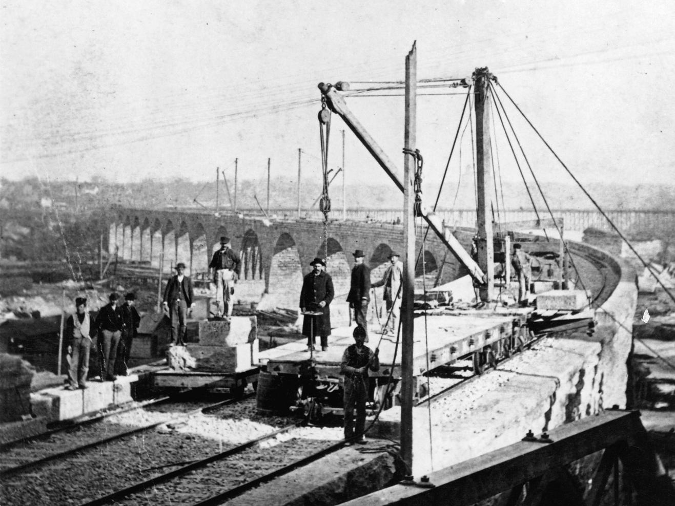 The Stone Arch Bridge deck being completed in 1883. (Burlington Northern, Minnesota Historical Society)