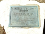 The plaque set in a boulder in Deming Heights Park.