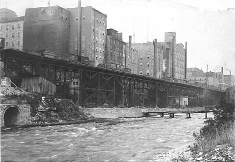 The west bank of the Mississippi River in downtown Minneapolis, just below St. Anthony Falls, in 1885. (Minnesota Historical Society)