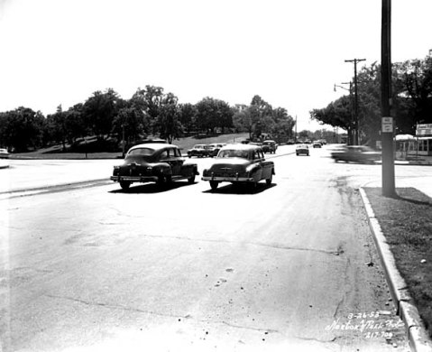 Travelling west on Lake St. at Dean Parkway. West Calhoun Parkway begins at far left. (Norton and Peel, Minnesota Historical Society)