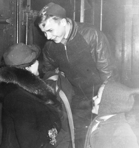 Roger Mosiman boarding train for 1940 National Speedskating Championship in Schenectady, NY. Roger is being sent off by his mother, Lillie, and younger sister, Bernice. (Photo courtesy of Gayle Mosiman Meadows)