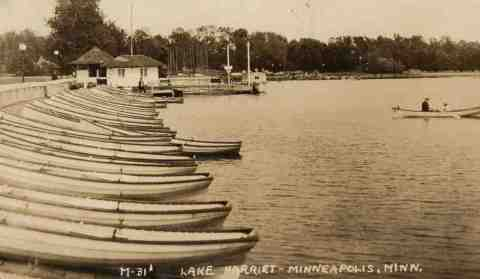 This photo was taken very shortly after the Lake Harriet pavilion was destroyed by a tornado in 1925. It's the only photo I've seen of Lake Harriet without a pavilion.  A pile of rubble marks the spot where the pavilion once stood. It's unlikely that a man as insistent upon beauty and efficiency as park superintendent Theodore Wirth would have allowed the rubble to remain for long, so this photo must have been taken in the few days after the storm in mid-July. (From the author's personal collection.)